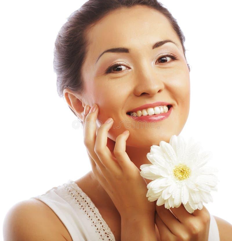 Asiatische Frau der neuen Gesundheit mit weißem gerber stockbild