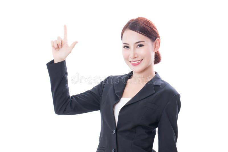 Asiatische Frau des jungen Geschäfts, die oben zeigt lizenzfreies stockfoto