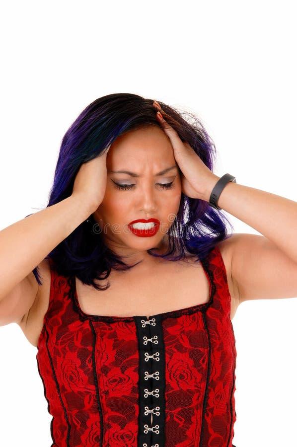 Asiatische Frau mit Kopfschmerzen stockbilder