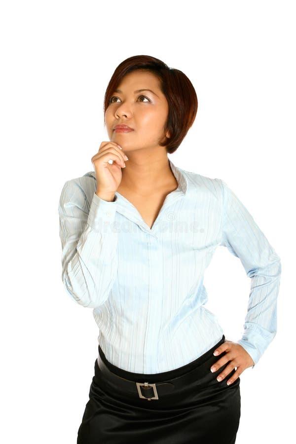 Asiatische Geschäftsfrau in denkender Haltung, stockbild