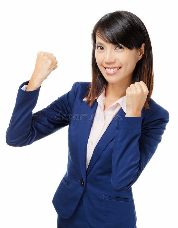 Asiatische Geschäftsfrau, die aufgeregt glaubt stockfotos