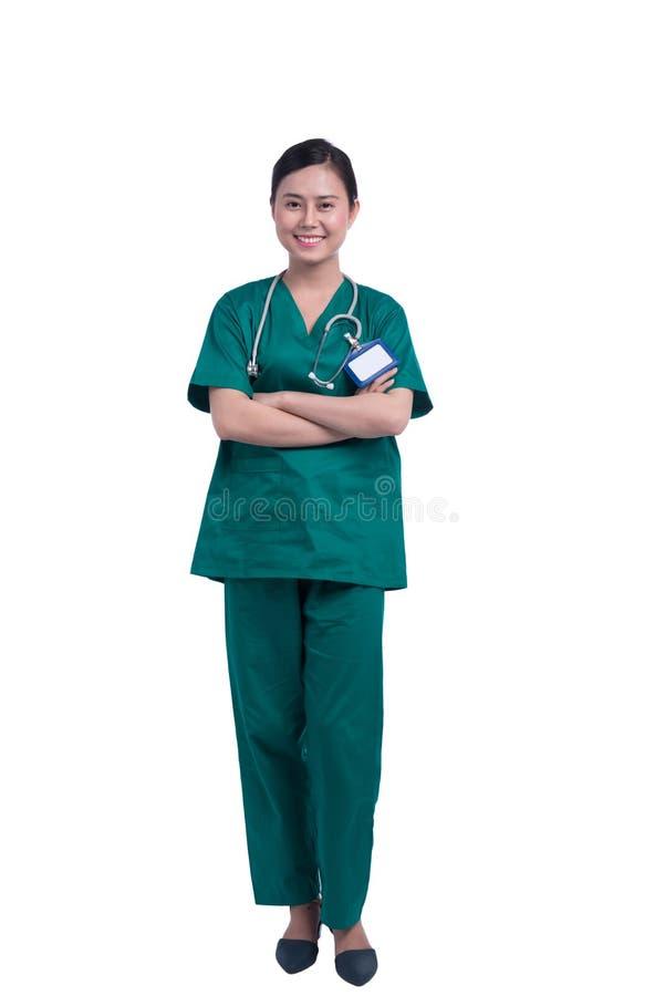 Asiatische Krankenschwesterstellung stockbild