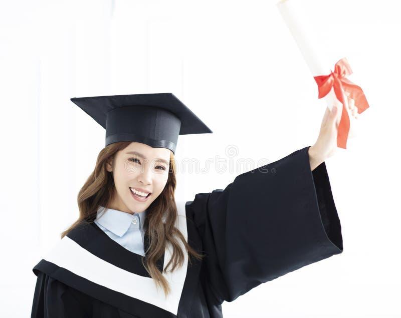Asiatische Mädchenstaffelung mit Diplom stockfotos