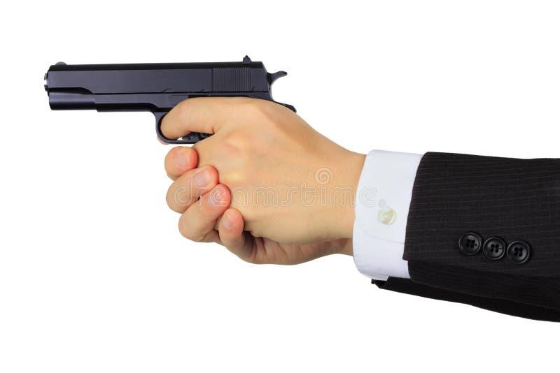 Asiatische männliche Hände, die ein Gewehr auf Weiß schießen stockfotos