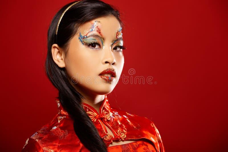 Asiatische Plastikpuppe stockfotos