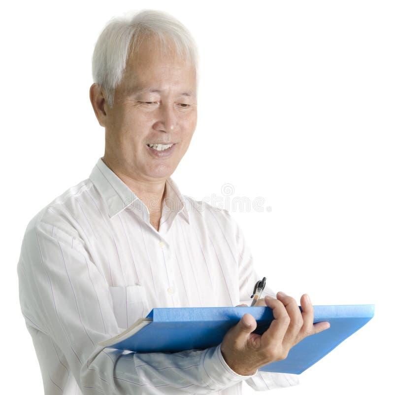 Asiatischer älterer Geschäftsmann stockfoto