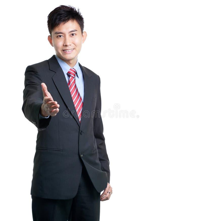Asiatischer chinesischer Geschäftsmann betriebsbereit zum Händedruck stockfotografie