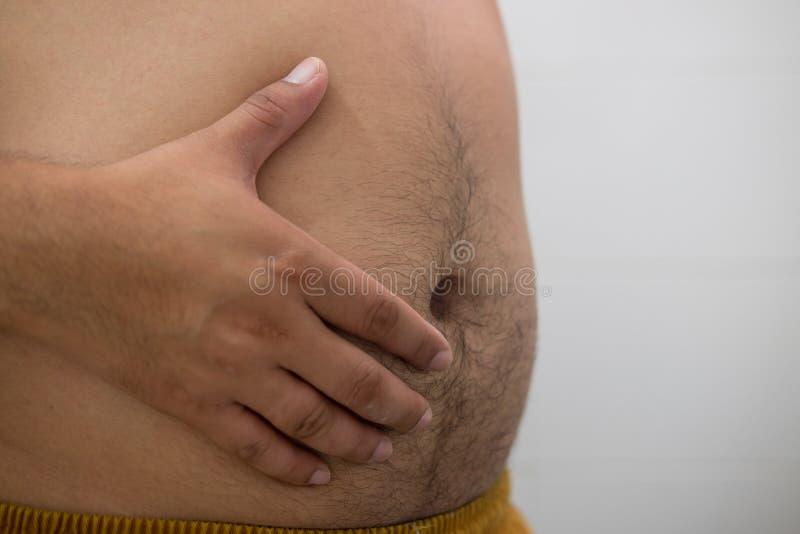 Asiatischer dicker Mann hat Cholesterin stockbilder