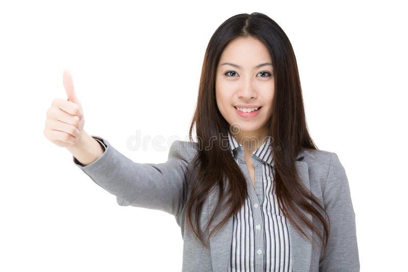 Asiatischer Geschäftsfraudaumen oben lizenzfreies stockfoto