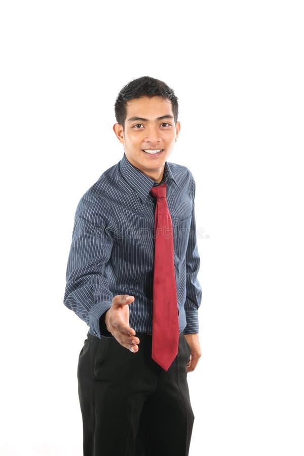 Asiatischer Geschäftsmann, der Hand rüttelt lizenzfreie stockfotos