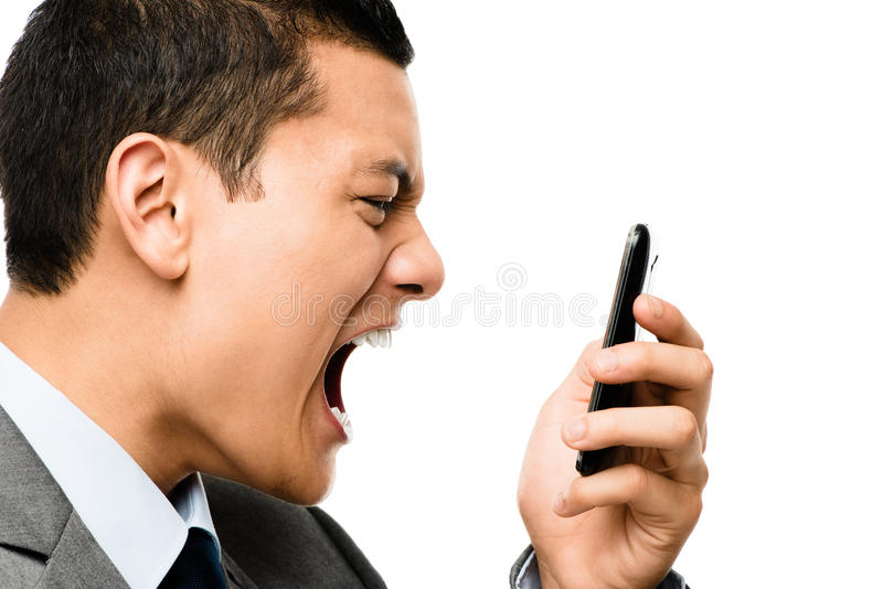 Asiatischer Geschäftsmann, der im Telefon schreit lizenzfreie stockfotos
