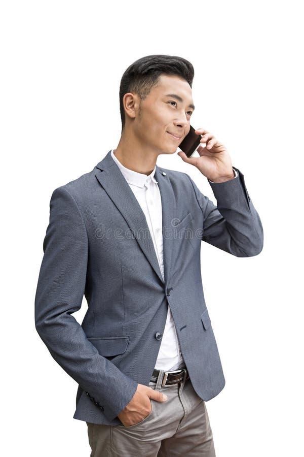 Asiatischer Geschäftsmann am Telefon, lokalisiert lizenzfreie stockfotografie