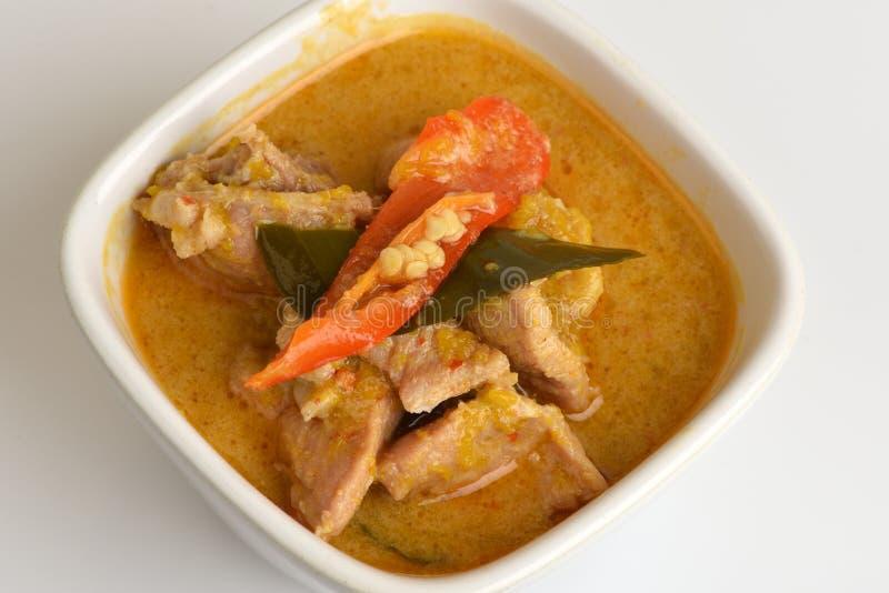 asiatischer Lebensmittelschweinefleischcurry stockfotos