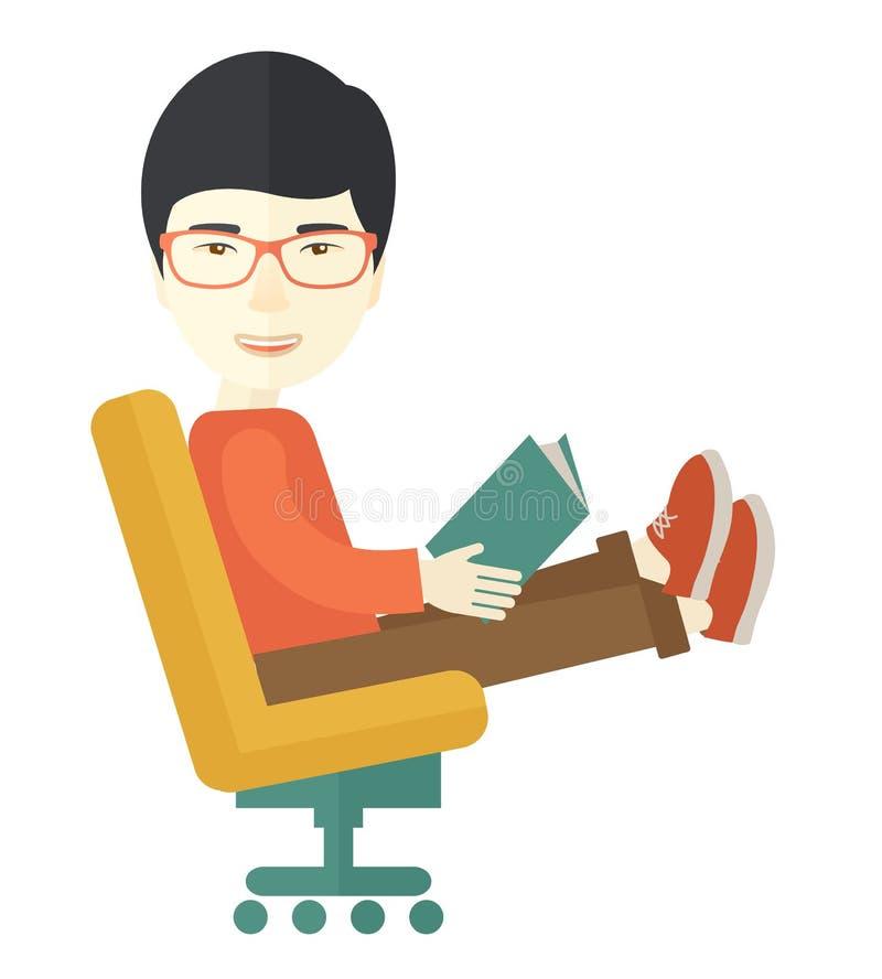 Asiatischer Mann, der mit einem Buch sitzt lizenzfreie abbildung