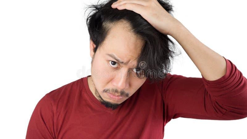 Asiatischer Mann erhält kahl stockbild