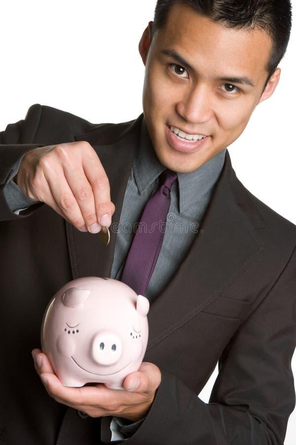 Asiatischer Piggybank Mann lizenzfreie stockbilder