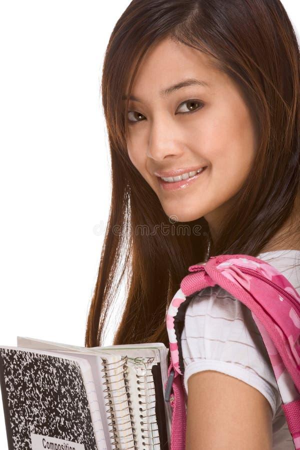 Asiatischer Student mit Rucksack und Notizbüchern lizenzfreie stockfotos