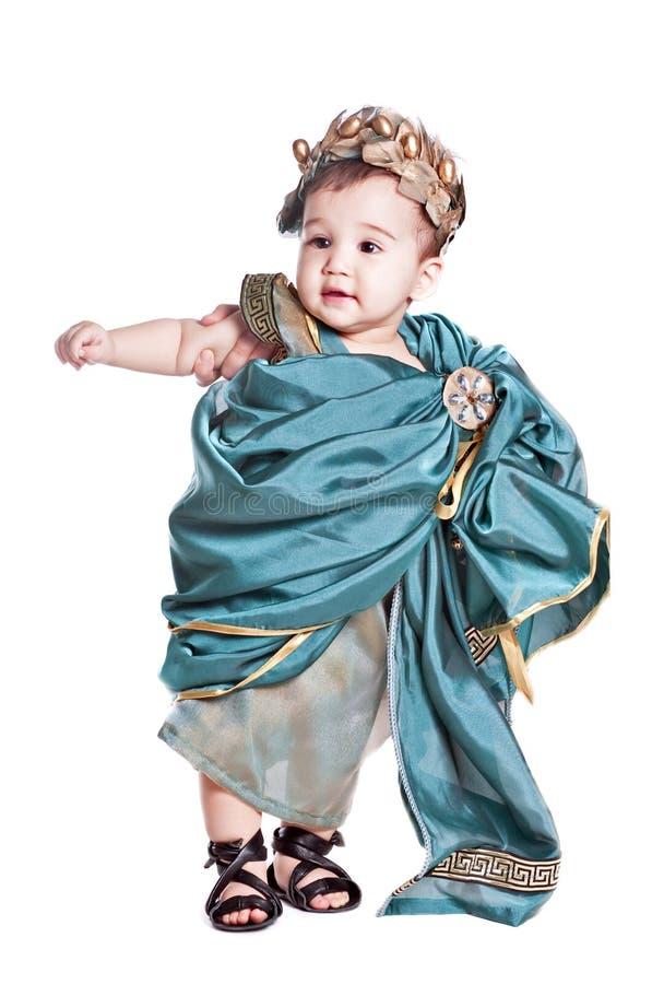 Asiatisches Baby in einem Abendkleid des Amoretto lizenzfreie stockbilder