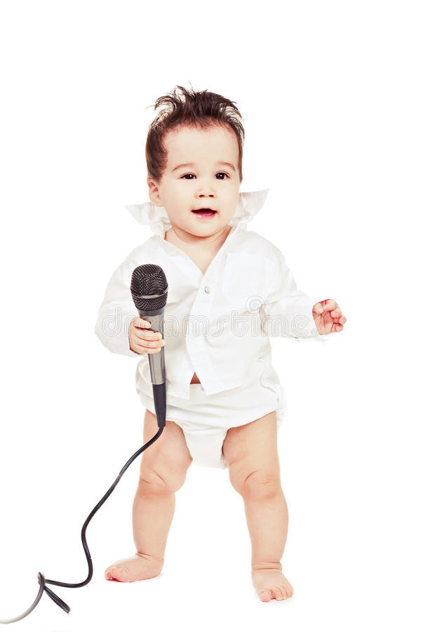 Asiatisches Baby mit Mikrofon stockfotografie