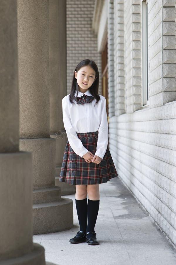 Asiatisches grundlegendes Schulmädchen lizenzfreie stockbilder