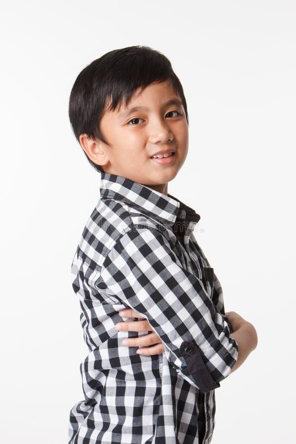 Asiatisches Jungenlächeln lizenzfreie stockbilder