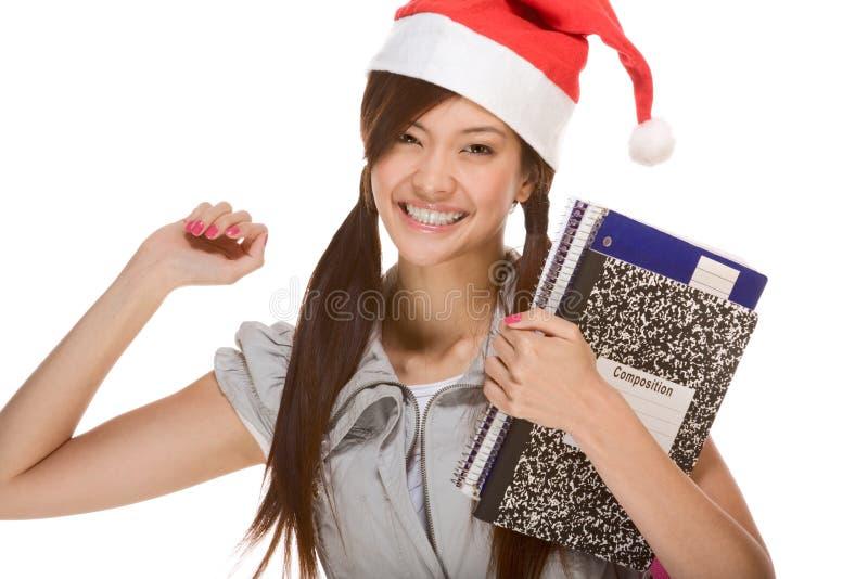 Asiatisches Kursteilnehmermädchen im Weihnachtssankt-Hut lizenzfreies stockfoto