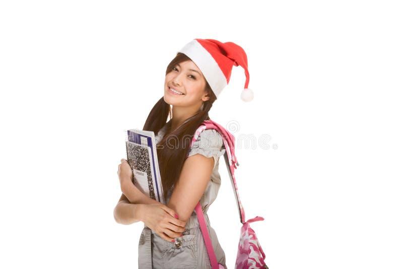 Asiatisches Kursteilnehmermädchen im Weihnachtssankt-Hut stockfoto