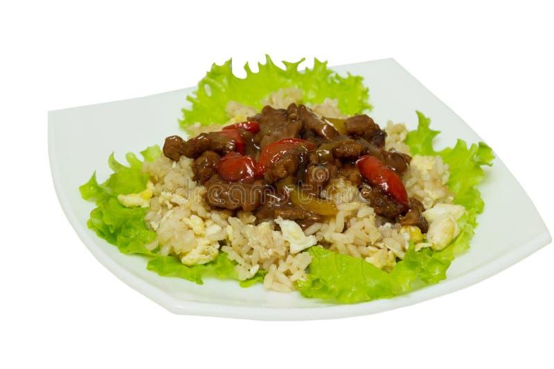 Asiatisches Lebensmittel - braten Sie Fleisch mit Gemüse und Reis stockfotos