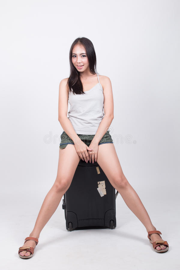 Asiatisches Mädchen im Reisekonzept stockbild