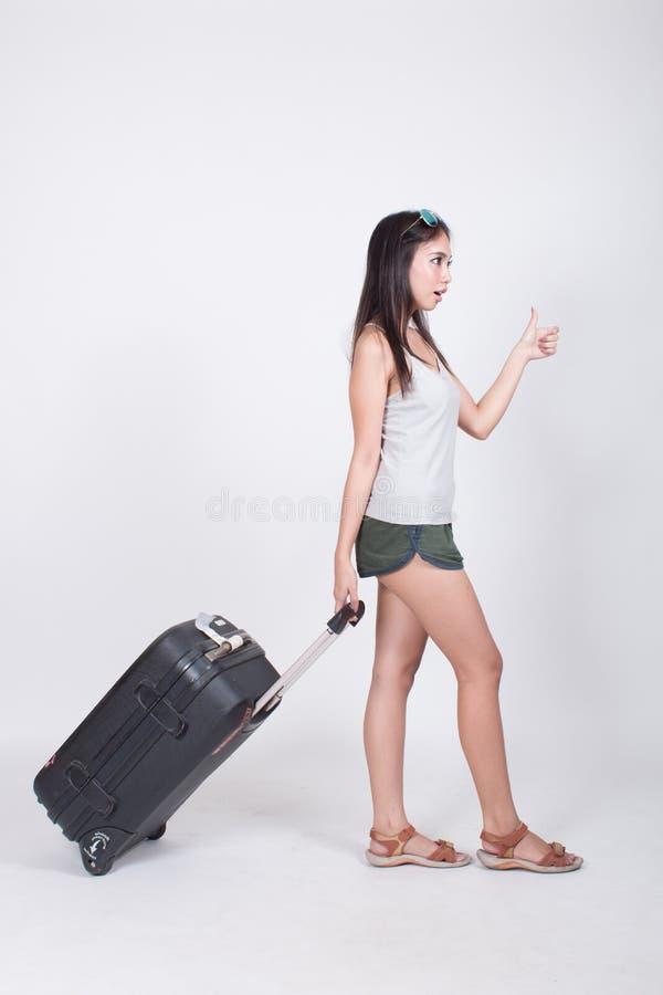 Asiatisches Mädchen im Reisekonzept lizenzfreie stockfotos