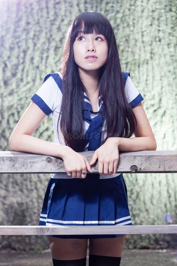 Asiatisches Schulmädchen des älteren Hochs stockfotos