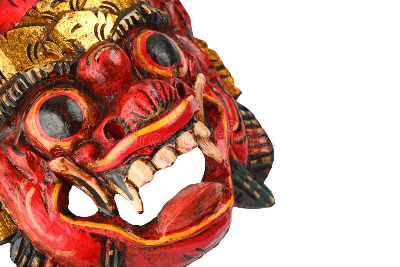 Asiatisches traditionelles hölzernes Rot malte Dämonmaske auf Weiß stockfoto