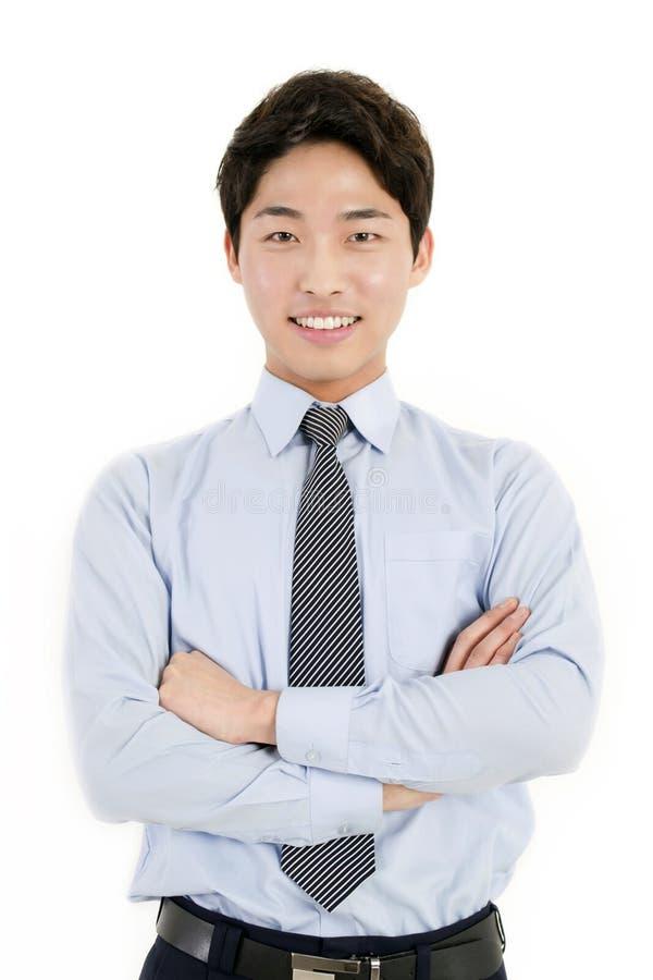 Asiatisk affärsman med hans korsade armar royaltyfria bilder