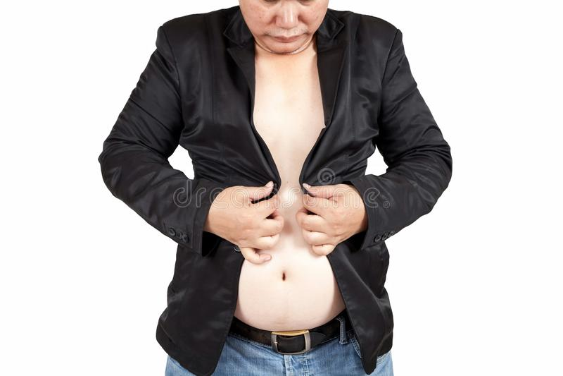 Asiatisk fet man som försöker att knäppas hans dräkter , Svårt att stänga th royaltyfria foton