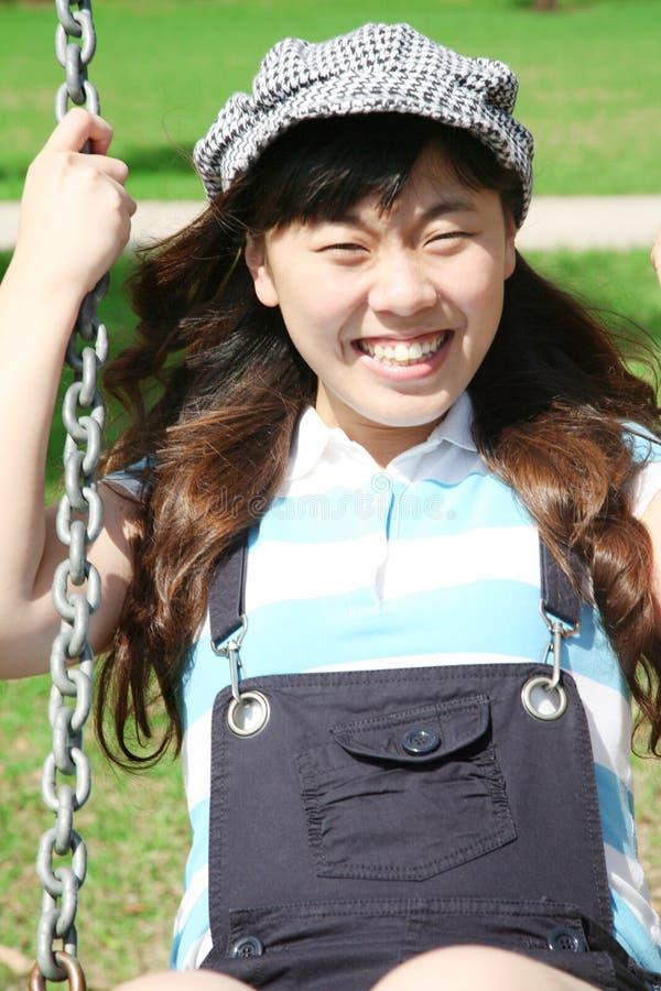 asiatisk flickaswing royaltyfri fotografi