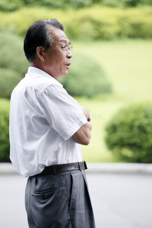 asiatisk gammalare man royaltyfri fotografi
