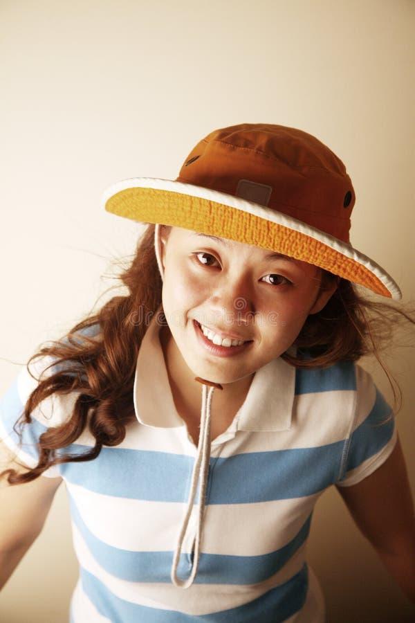 asiatisk gullig flickahatt royaltyfri bild