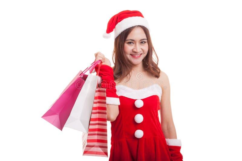 Asiatisk julSanta Claus flicka med shoppingpåsar royaltyfria bilder