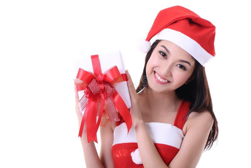 Asiatisk jultomtenflicka för jul arkivbild
