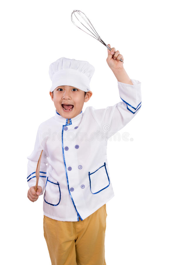 Asiatisk kinesisk pojke i vita kockUniform Holding Baking hjälpmedel arkivfoton