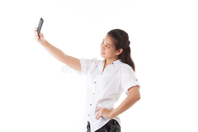 Asiatisk kvinna för skönhet som använder den smarta telefonen royaltyfri bild