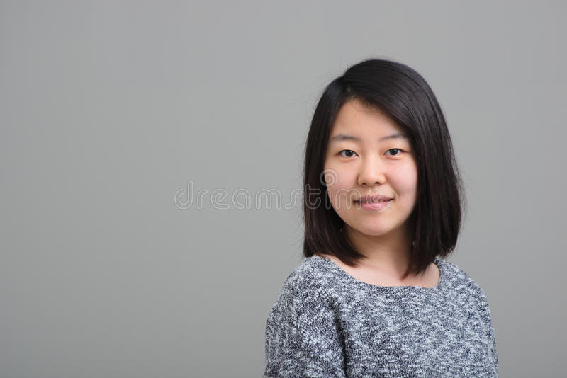 asiatisk le kvinna royaltyfri fotografi