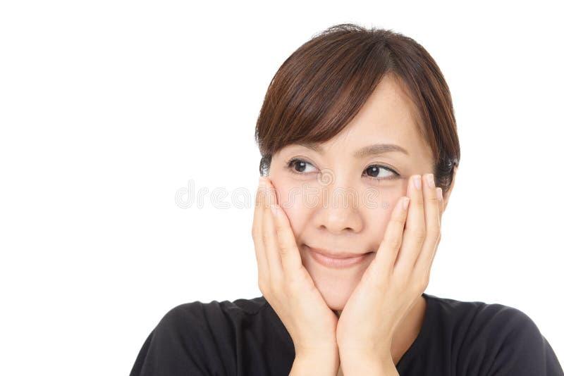 asiatisk le kvinna arkivfoto