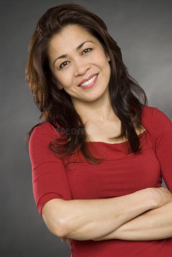 asiatisk lycklig le kvinna arkivfoto