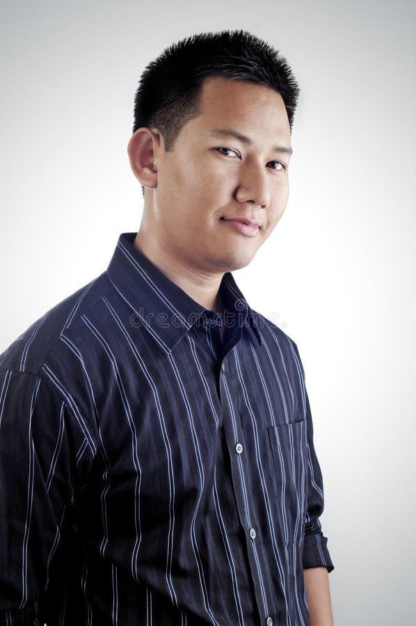 asiatisk male stående royaltyfri foto