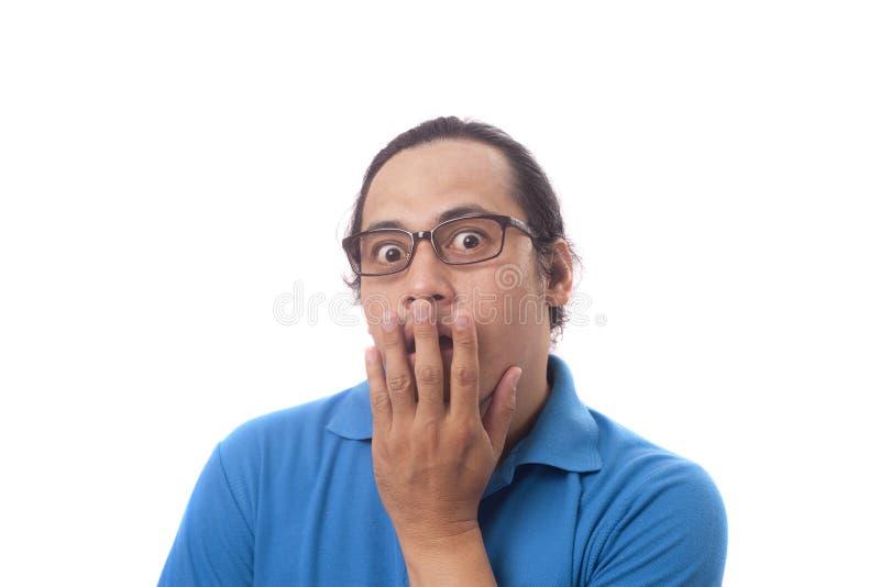 Asiatisk man som chockas och st?ngs hans mun arkivbild