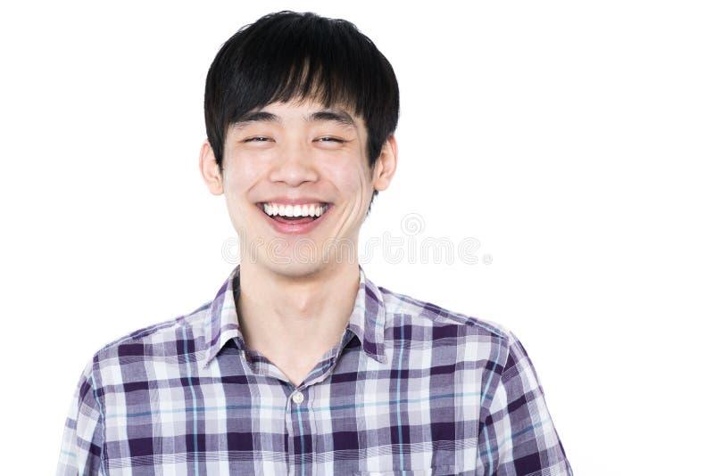Asiatisk man - som isoleras på vit bakgrund fotografering för bildbyråer