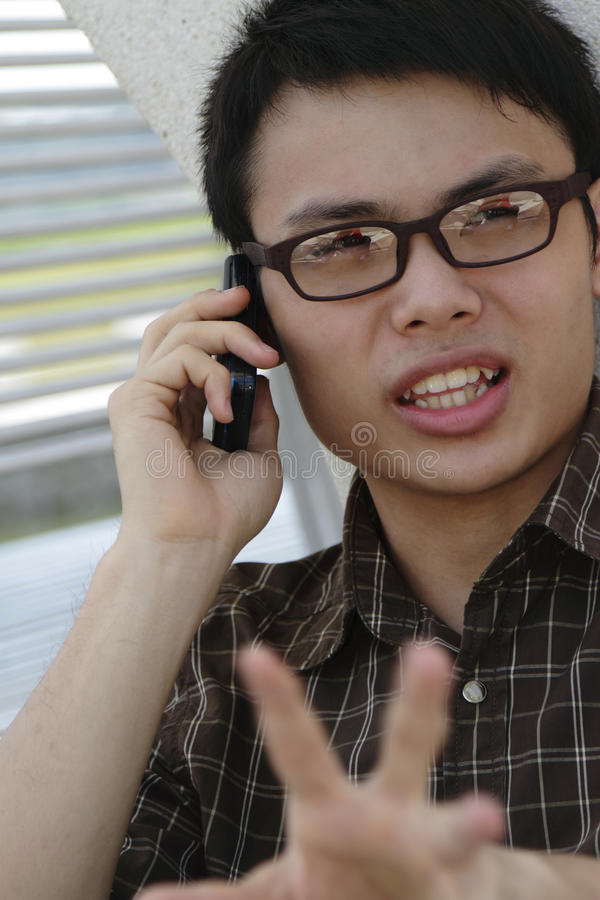 asiatisk mantelefon royaltyfri foto