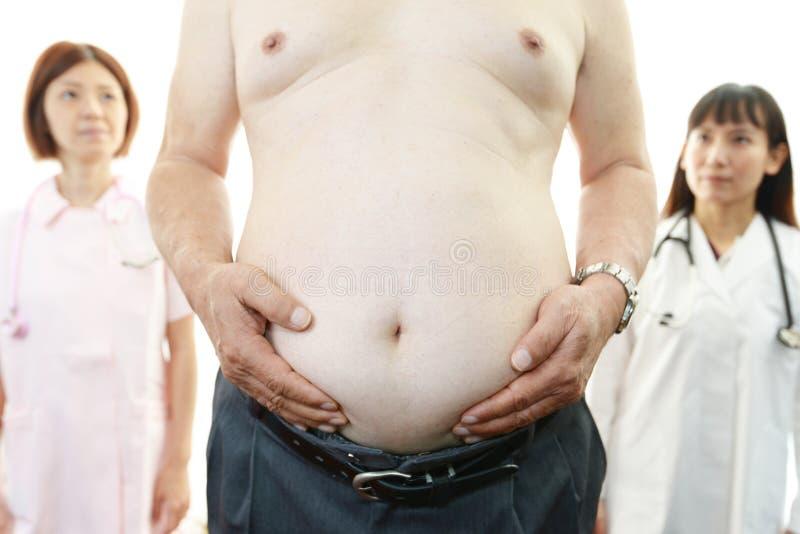 Asiatisk medicinsk personal med tålmodig fetma arkivfoto