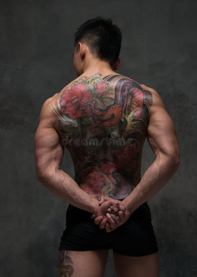 Asiatisk modell med tatueringen royaltyfria foton